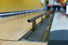 Bowling alley background, lane with bumper rails. Bowling alley background. Lane with bumper rails closeup. Leisure activity club Royalty Free Stock Images