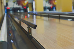 Bowling alley background, lane with bumper rails. Bowling alley background. Lane with bumper rails closeup. Leisure activity club Stock Images