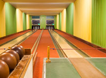 Bowling alley with balls. A Bowling alley with balls and pins Royalty Free Stock Photography