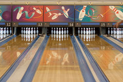 Bowling alley. Lanes set up with white pins Stock Photos