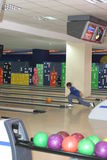 Bowling alley with players Royalty Free Stock Photos