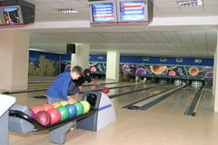 Bowling alley with players Royalty Free Stock Images