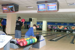 Bowling alley with players Royalty Free Stock Image