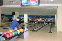 Bowling alley with players Stock Photo