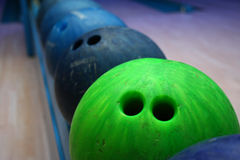 Bowling ball. Old bowling balls in line on the bowling track Royalty Free Stock Images
