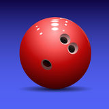 Bowling ball on a blue background Royalty Free Stock Photo