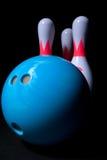 Bowling ball and bowling pins. Blue bowling ball and bowling pins Royalty Free Stock Images
