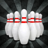 Bowling ball breaks standing pins. Grunge style Royalty Free Stock Photo
