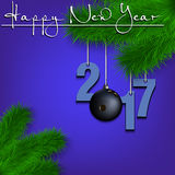Bowling ball and 2017 on a Christmas tree branch. Happy New Year and numbers 2017 and bowling ball as a Christmas decorations hanging on a Christmas tree branch Stock Image