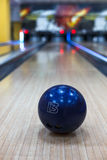 Bowling ball closeup on lane background Royalty Free Stock Photo