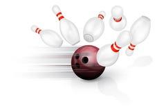 Bowling ball crashing into the pins Royalty Free Stock Images