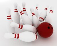 Bowling ball crashing into the pins Stock Photography