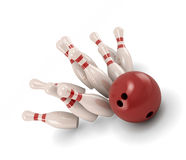 Bowling ball crashing into the pins Royalty Free Stock Photos