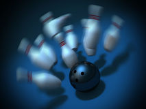 Bowling ball crashing into the pins. strike shot Stock Photos