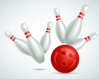 Bowling ball crashing into the pins Stock Photography