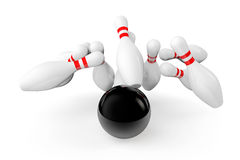 Bowling Ball crashing into the pins Stock Photos