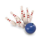 Bowling ball crashing into the pins Stock Photo