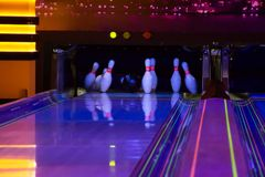 Bowling. Ball does strike on ten pin bowling in skittle-ground stock photography