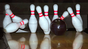 Bowling ball and falling pins. Closeup of a bowling ball and falling pins stock photography