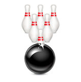 Bowling ball in front of bowling pins isolated on white Royalty Free Stock Image