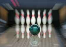 Bowling ball going into the pins. Motion blur Royalty Free Stock Photography