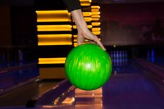 Bowling ball. In the hand of player royalty free stock photography