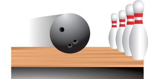 Bowling ball heading for pins. Bowling ball rolling down the alley heading for the pins Royalty Free Stock Photography