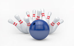 Bowling ball hits skittles Royalty Free Stock Images