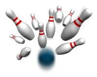 Bowling ball hitting pins Royalty Free Stock Photos