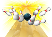 Bowling ball hitting pins Stock Image