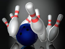Bowling ball hitting skittles Stock Image
