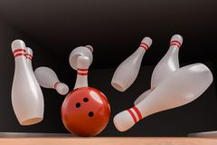 Bowling ball is knocking down pins Strike. 3D rendered illustration Royalty Free Stock Photos