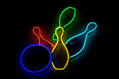 Bowling ball knocking skittles neon sign Royalty Free Stock Photo