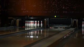 Bowling ball knocks down skittles. The bowling ball knocks down all the skittles stock video footage