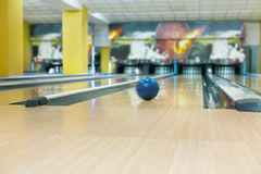Bowling ball on lane background. Bowling accessories background. Interior of bowling alley, lane with ball Royalty Free Stock Photos