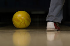 Bowling Ball Next To The Foot Royalty Free Stock Photos