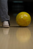 Bowling Ball Next To The Foot Stock Photography