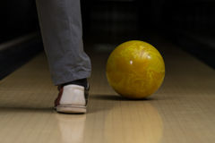 Bowling Ball Next To The Foot. Close-Up Of A Foot Next To A Bowling Ball On A Bowling Lane Royalty Free Stock Images