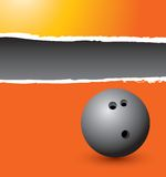 Bowling ball on orange ripped advertisement Stock Photo