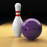 Bowling ball, pin and lane as a composition. Mauve bowling ball, pin, lane as basic elements of ten pin bowling on black background Royalty Free Stock Images