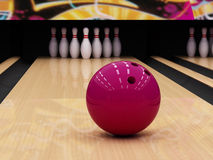 Bowling ball and pins. Big red bowling ball and pins Stock Photo