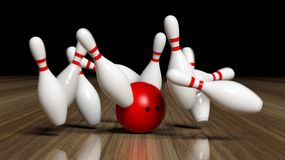 Bowling ball and pins in motion Stock Image
