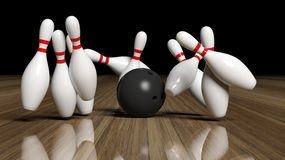 Bowling ball and pins in motion. On wooden floor Stock Photos