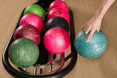 Bowling ball in player man hand Royalty Free Stock Image