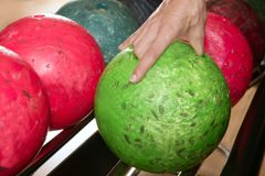 Bowling ball in player man hand Royalty Free Stock Images