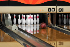 Bowling - Ball reaching Pins stock images