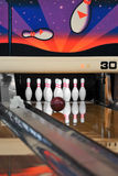 Bowling - Ball reaching Pins Vertical. Motion blur on ball royalty free stock photography