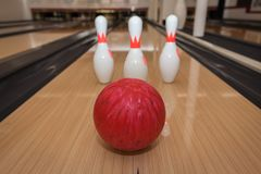 The bowling ball is ready to strike. In sport center stock photography