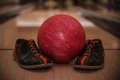 The bowling ball is ready to strike. In sport center stock photos