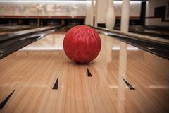 The bowling ball is ready to strike. In sport center stock photo